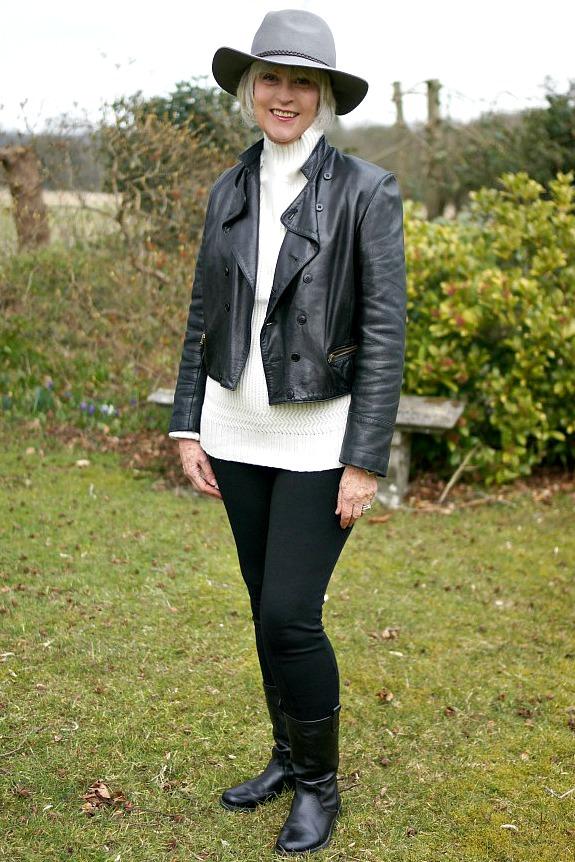 Black leather biker jacket with cream sweater